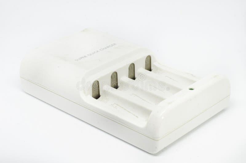Batteriuppladdare som isoleras på vit bakgrund royaltyfria foton