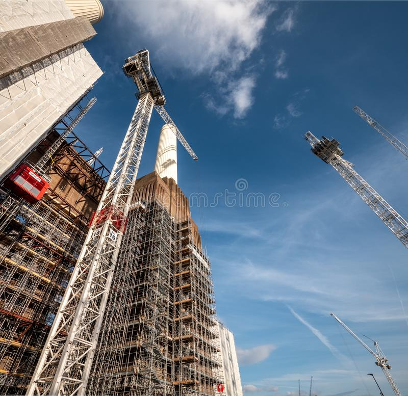 Battersea Power Station redevelopment, London. LONDON, UK - 31 OCTOBER 2018: A low angle view of the scaffolding, cranes and construction works being carried out royalty free stock image