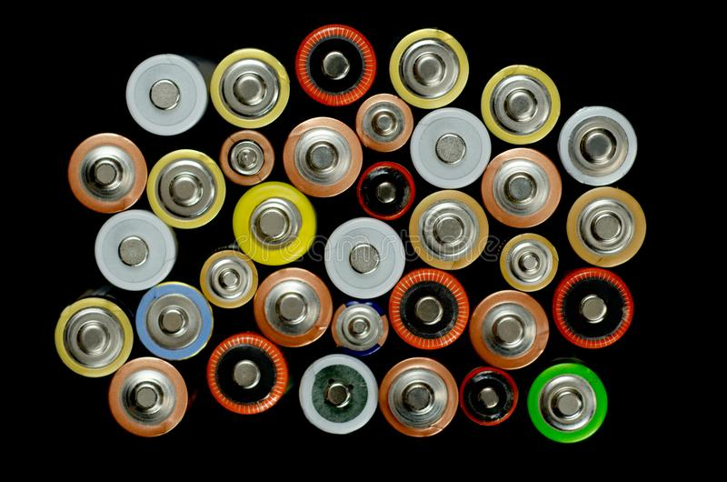 Battery on a black background stock image