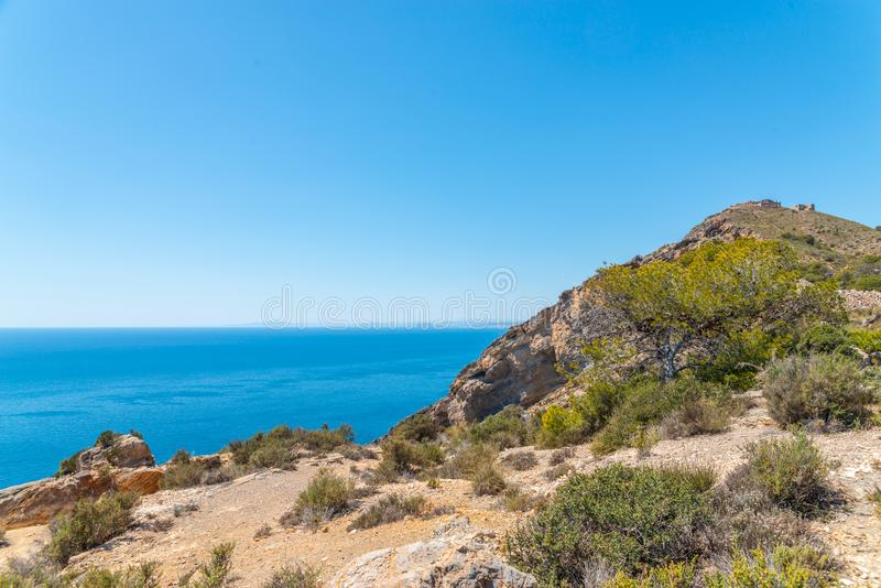 BATTERY CASTILLITOS, SPAIN - APRIL 13, 2019 Abandoned military constructions located in the hills near the bay of Cartagena. BATTERY CASTILLITOS, SPAIN - APRIL royalty free stock photography