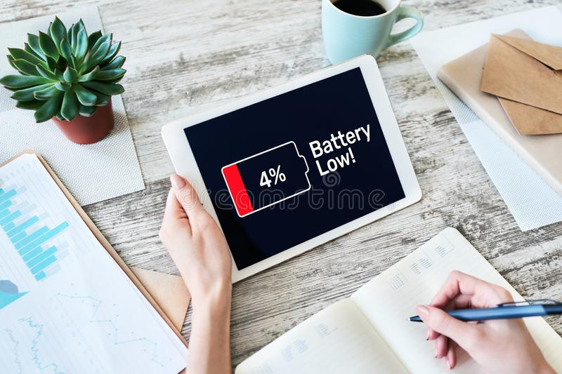 Battery low message on mobile device screen. Internet and technology concept. royalty free stock photography