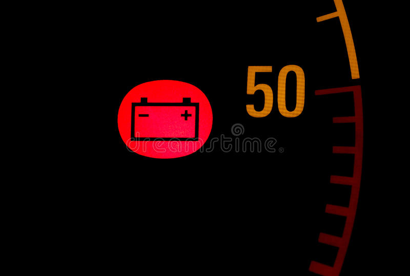 Battery low red light icon on car dashboard stock photography