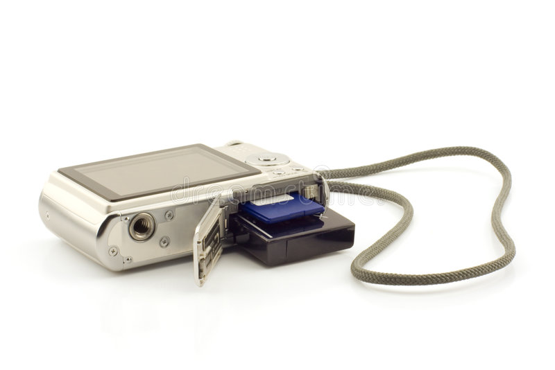 Battery and memory card in a compact camera royalty free stock image