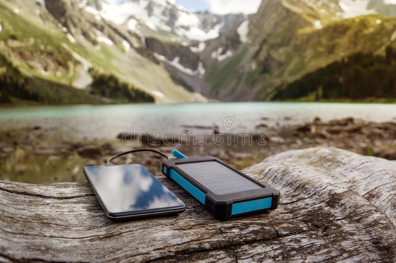 Battery solar energy device on the background of beautiful mountain scenery. stock photography