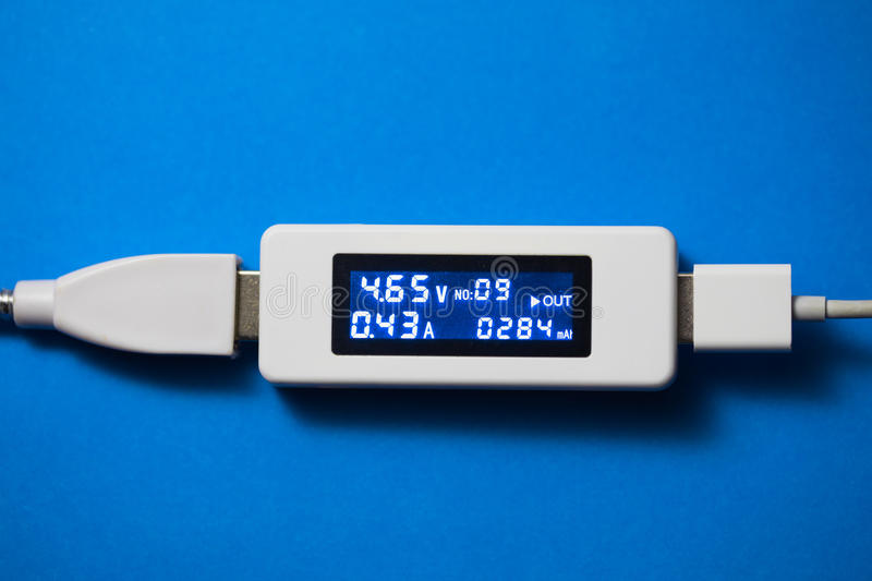 Battery tester diagnostic tool. Blue background stock images