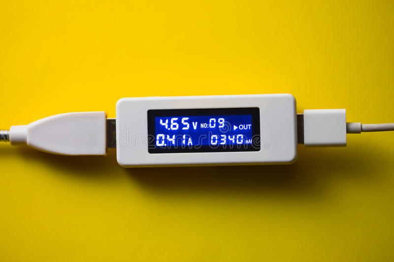 Battery tester diagnostic tool. Yellow background stock photos
