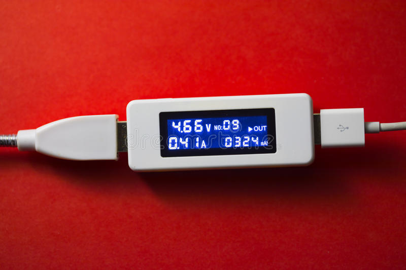 Battery tester diagnostic tool. Red background stock photos