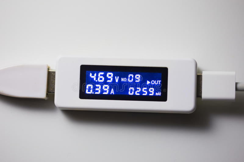 Battery tester diagnostic tool. White background royalty free stock photo