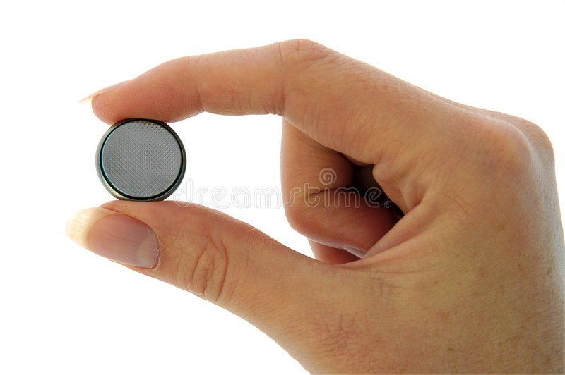 Battery - Watch Battery (CR2025) - Pinch - Minus Stock Image