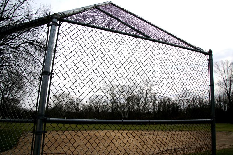 This batting cage and field are waiting for warm weather and springtime. stock image