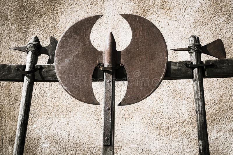 Battle axes, medieval weapons. A monochrome of three battle axes, medieval weapons stock photo
