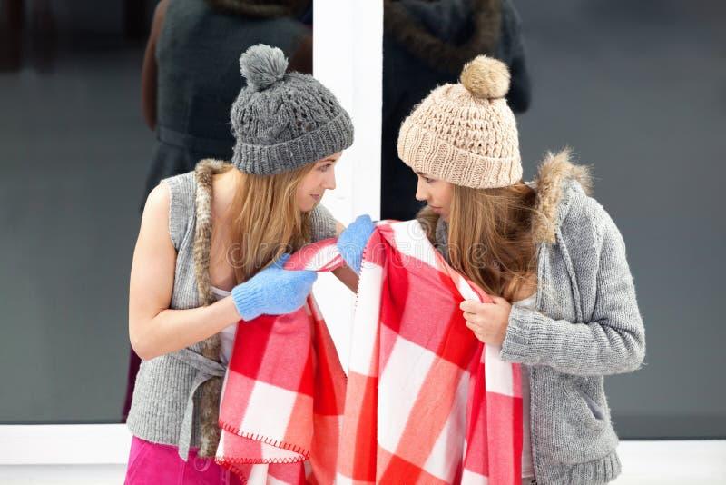 Battle for blanket. Two girls fighting for blanket royalty free stock photo