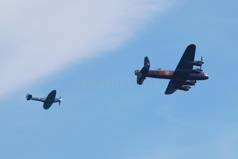 Battle of Britain Memorial Flight. Avro Lancaster bomber PA474 and Spitfire fighter PS915, of the Battle of Britain Memorial Flight, perform at the Airbourne royalty free stock photography