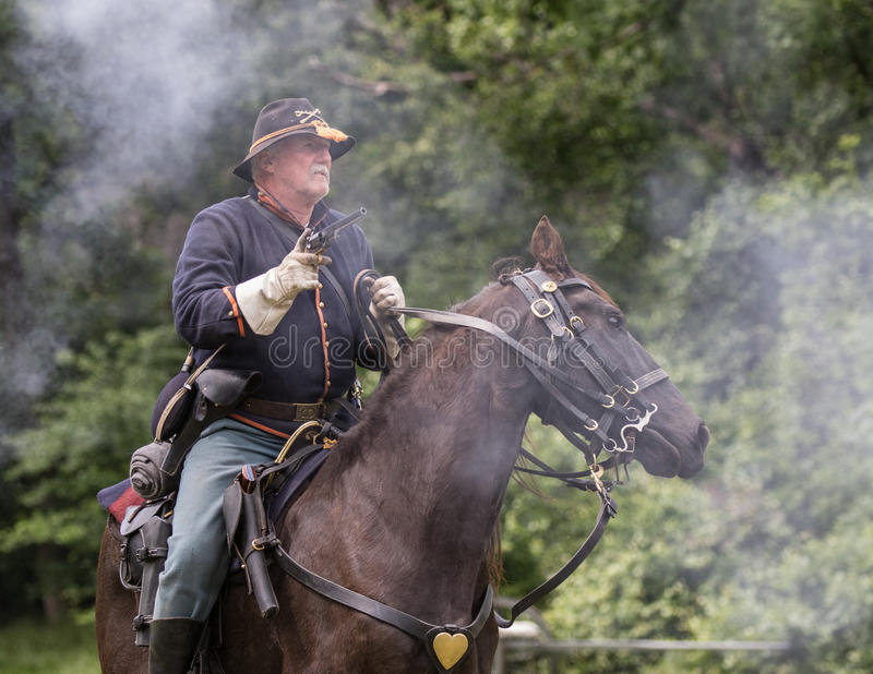 Battle on Horseback. Civil War era soldiers in battle at the Dog Island reenactment in Red Bluff, California stock photography