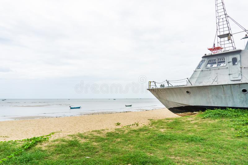 Battle metal ship on sand beach. Old Battle metal ship on sand beach stock images