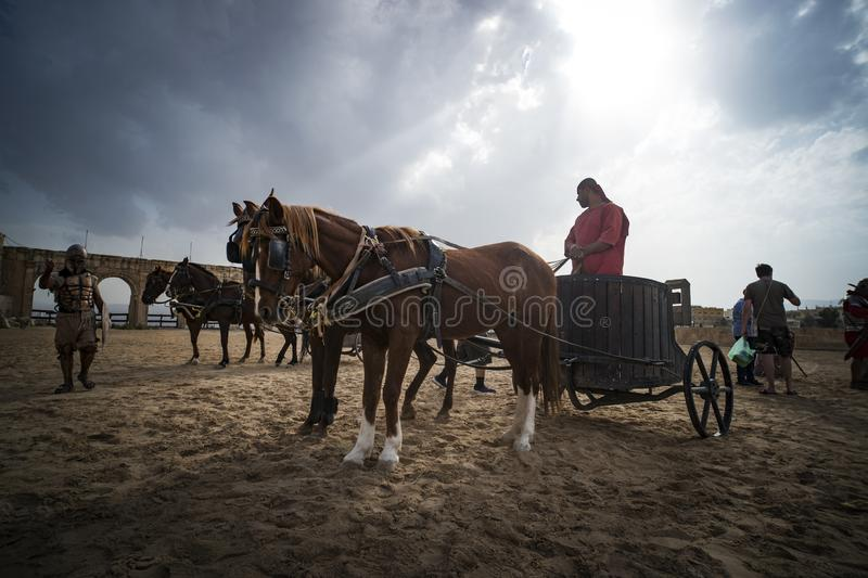 Battle Roman chariot with a rider. Entertainment for tourists at the walls of the ancient city of Jarash. royalty free stock photo