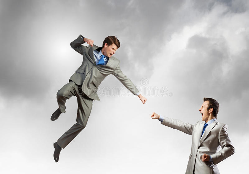 Battle of two businessmen stock photos