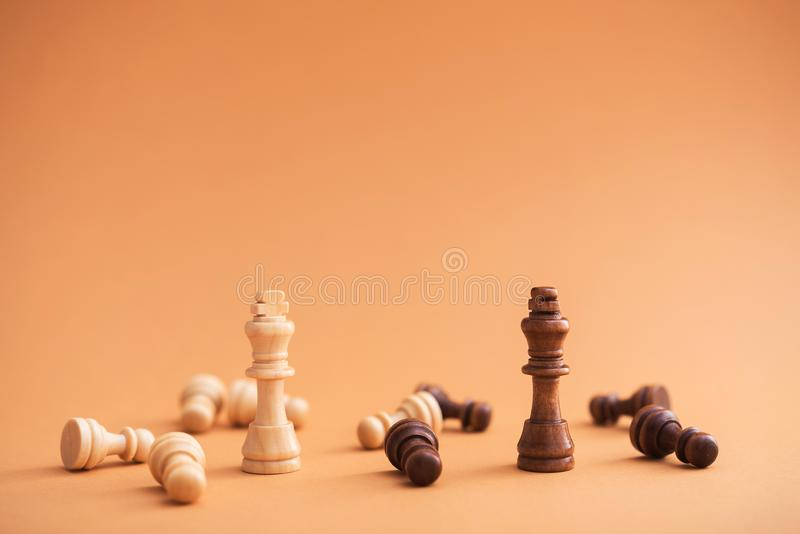 Battle between white and black chess pieces. Minimal style concept royalty free stock images