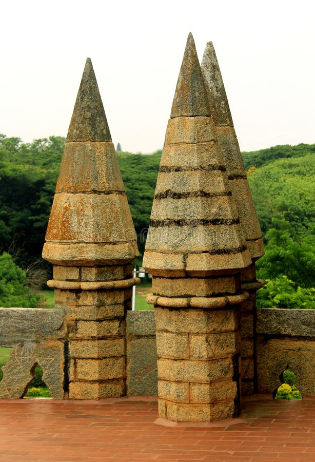 The battlement of bangalore palace with trees. stock photo