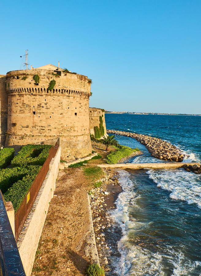 Castello Aragonese castle of Taranto. Apulia, Italy. Battlement of Castello Aragonese castle of Taranto at sunset. Apulia, Italy stock images