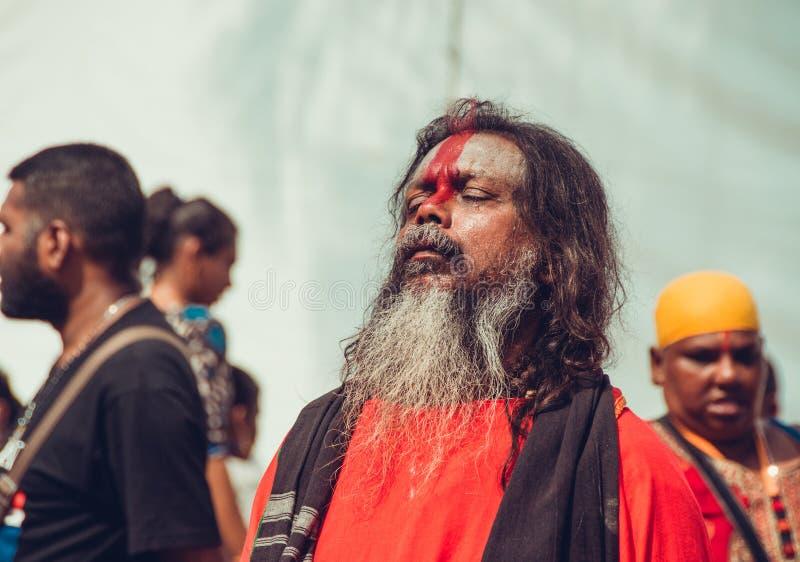 BATU CAVA, SELANGOR, MALÁSIA - 31 de janeiro de 2018 os devotos hindu comemoram o festival de Thaipusam Retrato dos povos Religiã imagem de stock royalty free