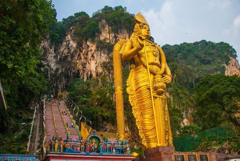 Batu Caves, gold statue Lord Murugan. Kuala Lumpur, Malaysia. The Batu Caves and the colossal statue of Lord Murugan in Kuala Lumpur, Malaysia. Temple cave or royalty free stock photos