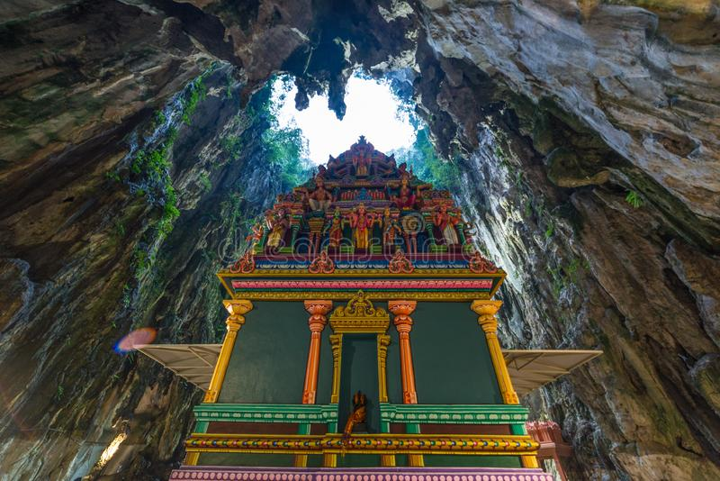 Batu Caves Kuala Lumpur Malaysia, scenic interior limestone cavern decorated with temples and Hindu shrines, travel destination in. South East Asia trip royalty free stock images