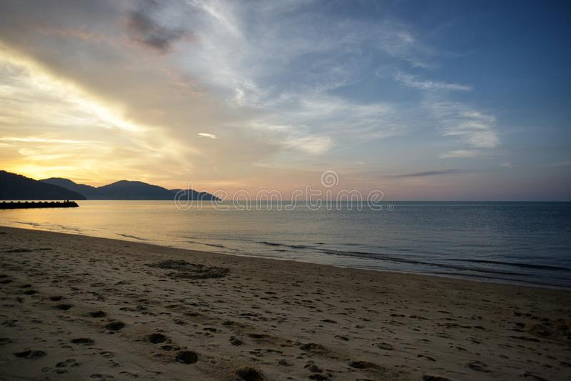 Batu Ferringhi Beach. And pier at sunset on Penang island in Malaysia royalty free stock images