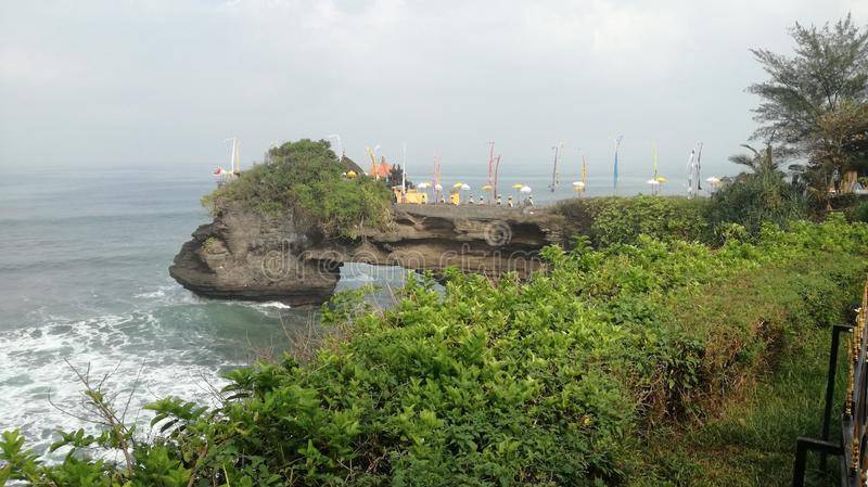 Batubolong temple at Tanah Lot. Batu Bolong temple at Tanah Lot Area locate in Beraban village Tabanan Regency stock photos