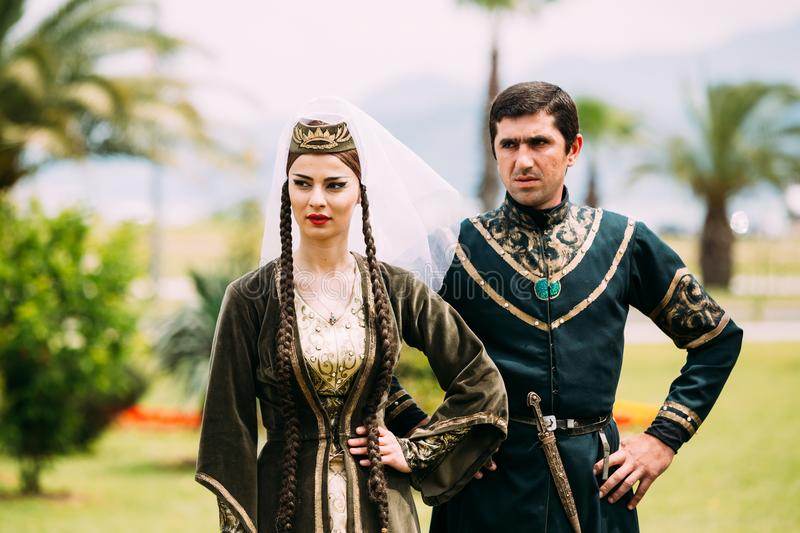 Batumi, Adjara, Georgia - May 26, 2016: Young couple of man and woman in Georgian national clothes in celebration of the. National holiday - the Independence stock photos