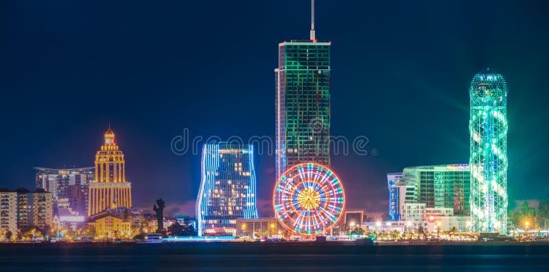 Batumi, Adjara, Georgia. Panorama Of Modern Architecture In Seafront. Miracle Park In Night Or Evening Illuminations Lights, Illuminated Resort Town Cityscape royalty free stock image