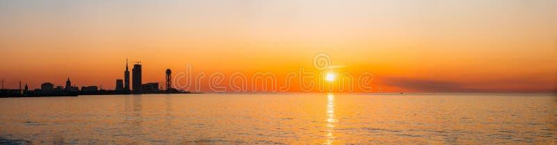 Batumi, Adjara, Georgia. Embankment At Sunset Sunrise. Bright. Batumi, Adjara, Georgia. Resort Town At Sunset Or Sunrise. Bright Orange Yellow Evening Sky. View royalty free stock image