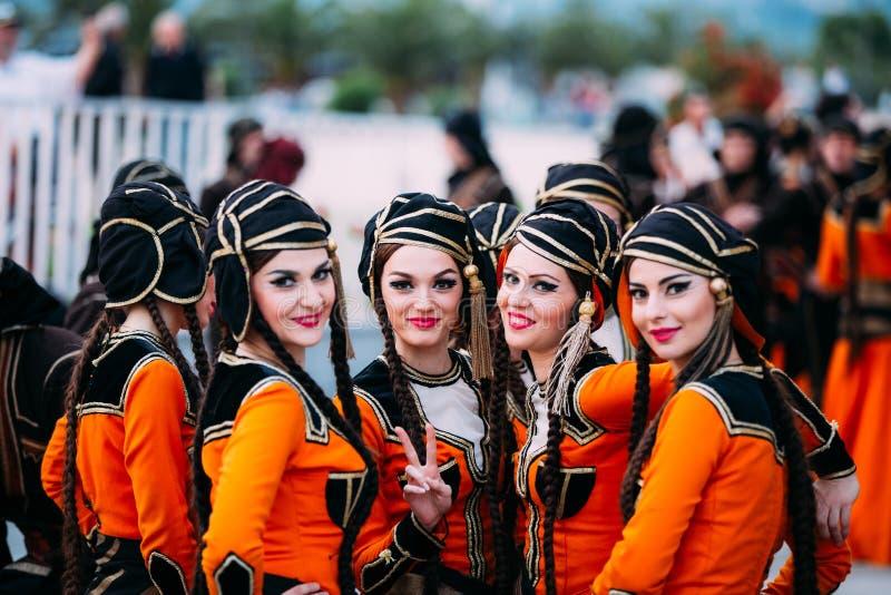 Batumi, Adjara, Georgia. Young women dressed in traditional folk. Batumi, Adjara, Georgia - May 26, 2016: Young women dressed in traditional folk costumes for royalty free stock images