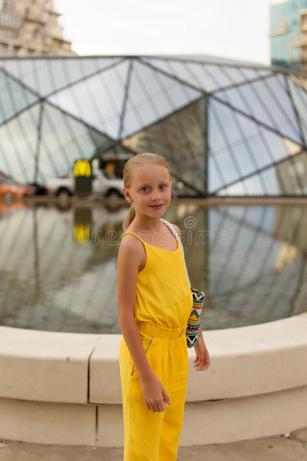 Batumi, Georgia - July 3, 2019: Cute girl on the background of McDonald`s fast food restaurant in Batumi royalty free stock photo