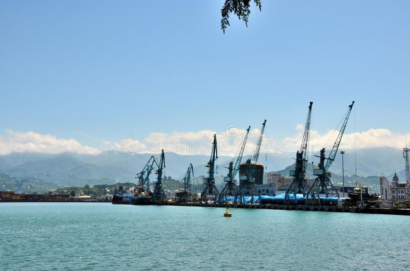 Black Sea port harbor International Container Terminal with cargo gantry cranes and mountains Batumi Georgia royalty free stock image