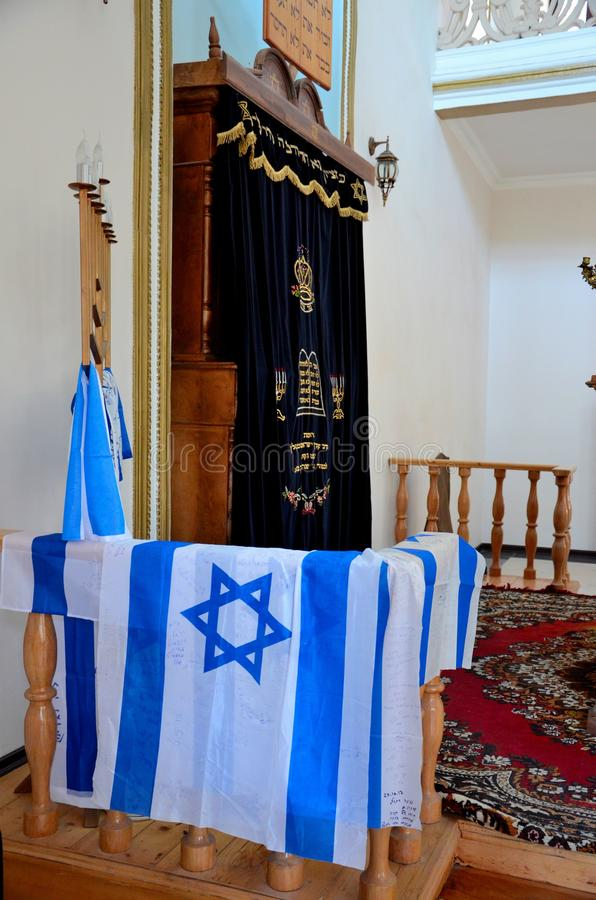 Israel flags menorah and altar inside Jewish synagogue Batumi Georgia stock photo