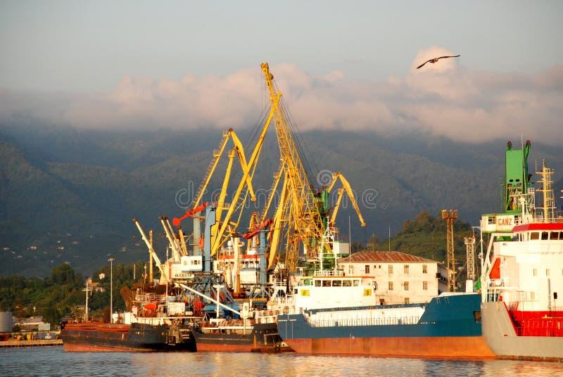 Batumi port at sunset, Georgia. Ships, cranes at Batumi port, Georgia royalty free stock photos