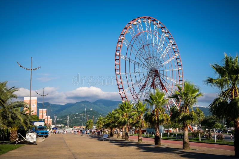 Batumi Seafront Boulevard with ferris wheel and mountains in the background stock image