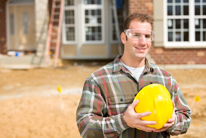 Bau: Auftragnehmer-tragende Schutzausrüstung lizenzfreies stockfoto