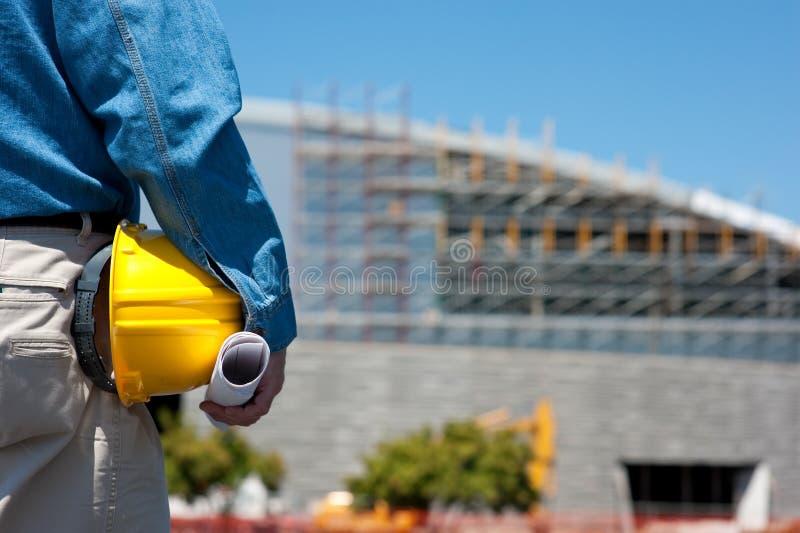 Bauarbeiter an der Baustelle lizenzfreies stockfoto