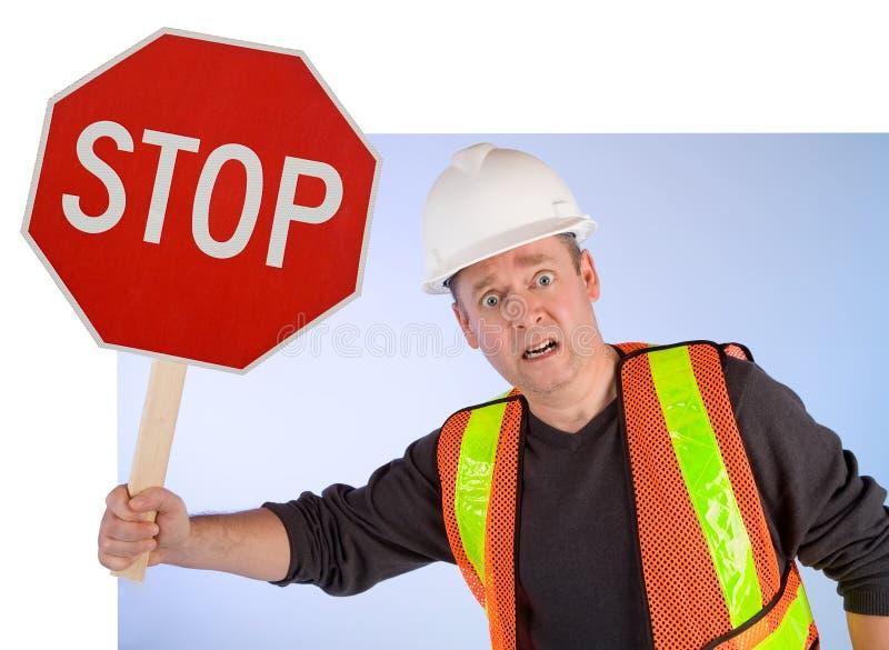 Bauarbeiter, der bittet etwas, zu tun zu stoppen stockfotos