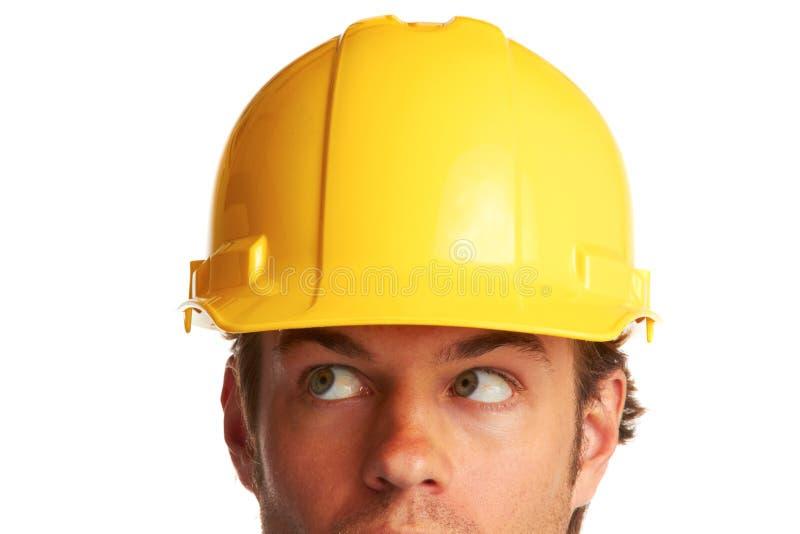 Bauarbeiter, der gesorgt schaut stockfotos