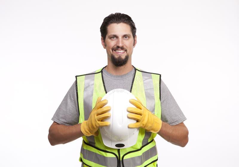 Bauarbeiter, der mit einem Hardhat aufwirft stockbilder