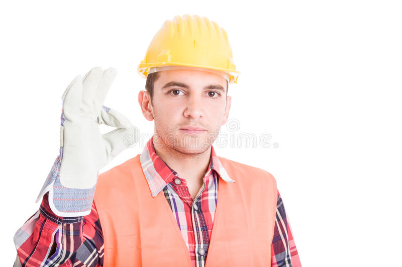 Bauarbeiter, der okaygeste zeigt stockbild