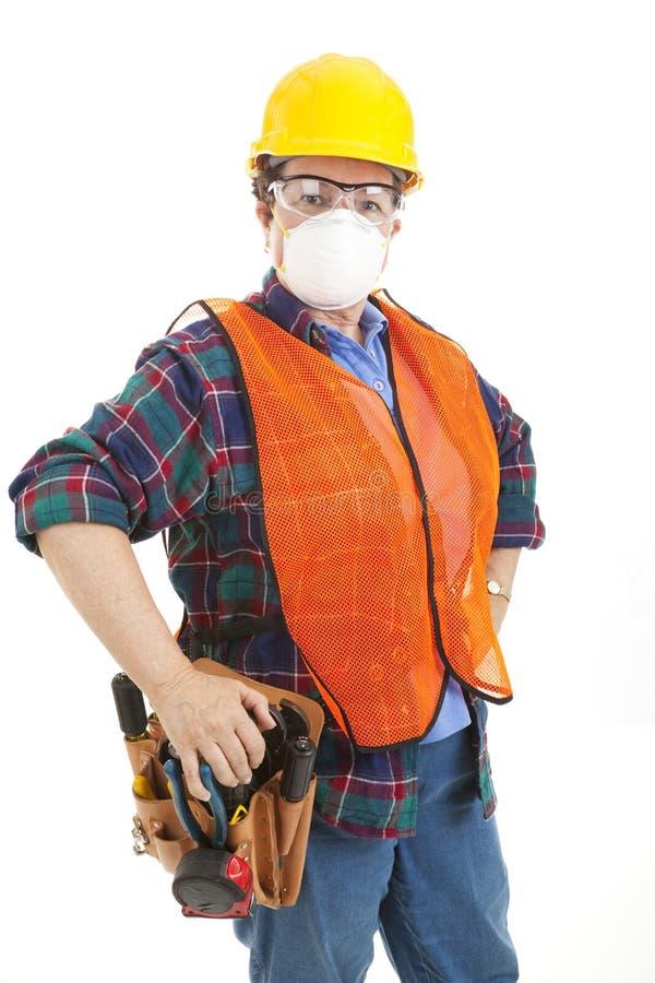 Bauarbeiter im Sicherheits-Gang stockbilder