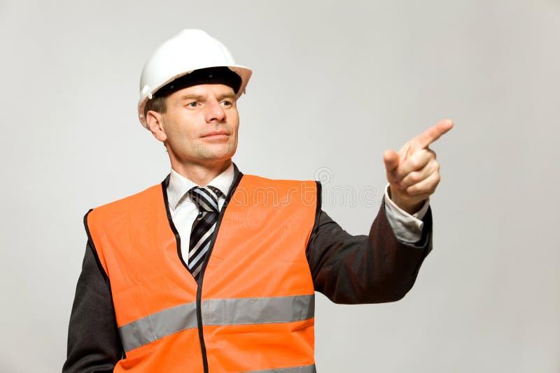 Bauarbeiterzeigen stockfotografie