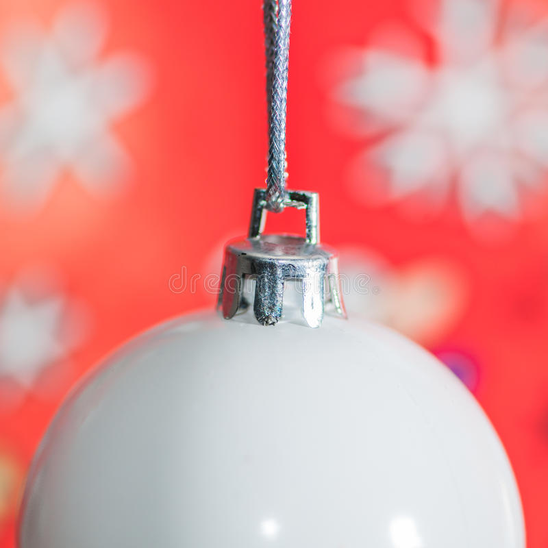 Bauble. A close-up of a Christmas bauble against a red background stock photo