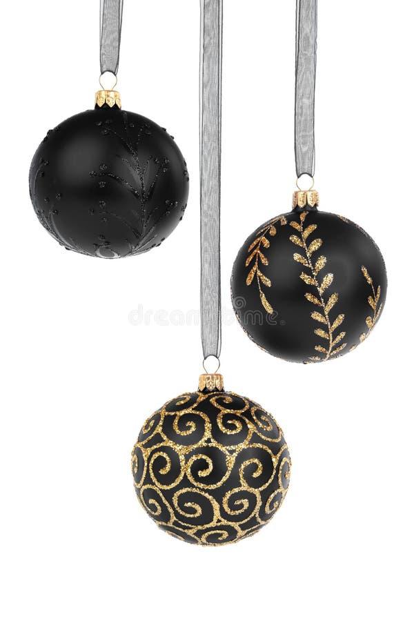 Baubles pretos do Natal imagens de stock