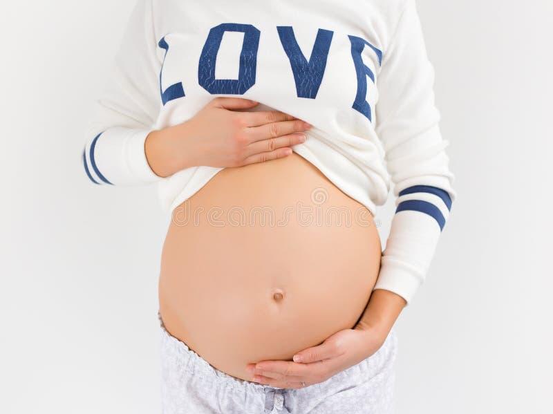Bauch der schwangeren Frau lizenzfreies stockbild