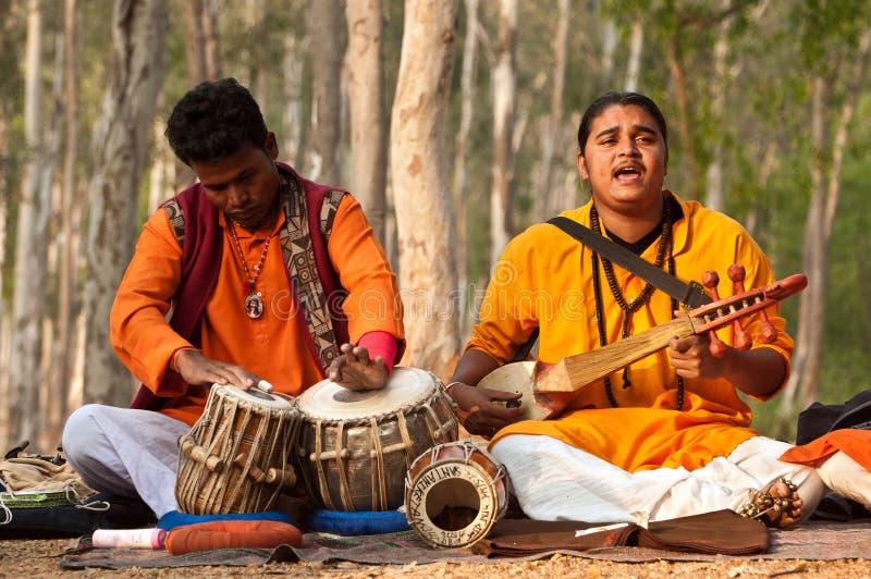 Baul folk band performance. SHANTINIKETAN, INDIA - DECEMBER 22: An Indian traditional baul folk band performs during the annual Poush Mela fair on December 22 stock images